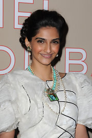 Sonam Kapoor's braided updo at the Chanel fashion show had an elegant vintage feel.