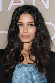 Freida Pinto wore rich shades of gray shadow to create her smoky-eyed look at the Chanel Paris-Bombay show.