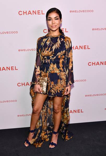 Jhene Aiko pulled her look together with a metallic gold clutch by Chanel.