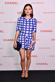 Phoebe Tonkin brightened up the black carpet with this electric-blue and pink grid-print dress by Chanel during the brand's Beauty House party.