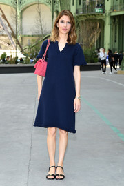 Sofia Coppola paired her dress with flat ankle-strap sandals by Chanel.