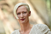 Tilda Swinton sported a slicked-down short 'do at the Chanel Haute Couture show.