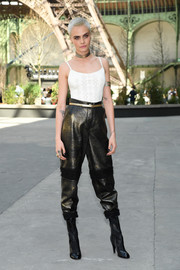 Cara Delevingne gave her simple top an edgy punch with a pair of leather and tweed pants by Chanel.