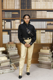 Amandla Stenberg donned a simple black button-down shirt for the Chanel Couture Fall 2019 show.
