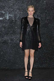 Ana Girardot's legs looked endless at the Chanel Haute Couture show in black patent platforms with delicate ankle straps.