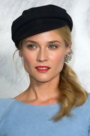 "Diane Kruger sported fashion's latest ""It"" item--the hat."