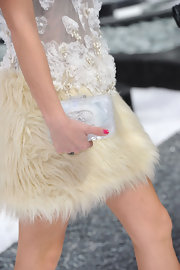 Leigh paired her fur embellished cocktail dress with a Fall 2010 Ice box clutch.