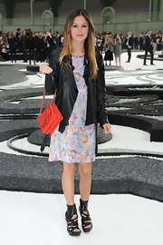 Rachel Bilson paired her floral print Resort 2011 dress with a bright red quilted shoulder bag.