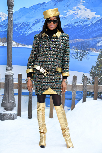 Naomi Campbell coordinated her suit with gold over-the-knee boots, also by Chanel.