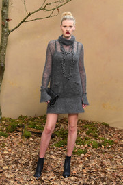 Lara Stone showed off her chic cold-weather style with this gray mohair turtleneck dress by Chanel during the brand's Fall 2018 show.