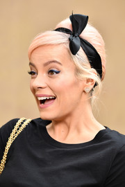 Lily Allen opted for a toned-down beehive when she attended the Chanel Fall 2018 show.