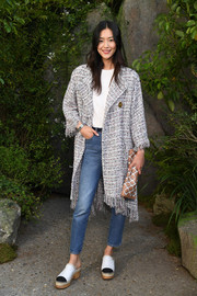 Liu Wen pulled her look together with a Chanel grid-print clutch.