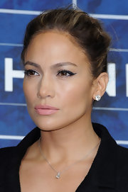 JLo strong stare smoldered at Paris Fashion Week—thanks to some seriously fierce cat-eyeliner.