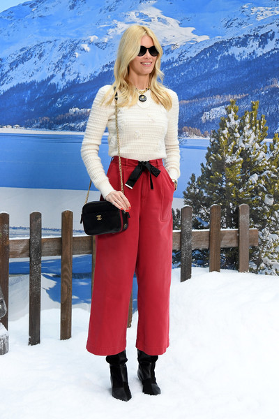 Claudia Schiffer kept cozy in a white crewneck sweater at the Chanel Fall 2019 show.