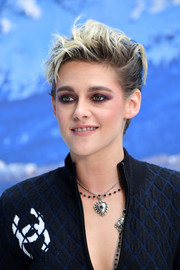 Kristen Stewart complemented her edgy 'do with a smoky eye.