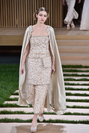 Gigi Hadid looked downright lavish in this richly textured gold strapless dress while walking the Chanel Couture show.