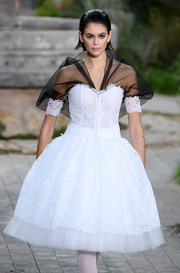 Kaia Gerber looked sweet in a white lace corset dress with a contrast yoke at the Chanel Couture Spring 2020 show.