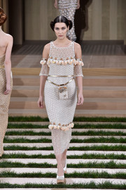 Bella Hadid sashayed down the Chanel Couture catwalk wearing this fully beaded cold-shoulder dress.
