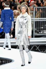 Lindsey Wixson looked futuristic in a silver leather coat with a fur collar and sleeves while walking the Chanel show.