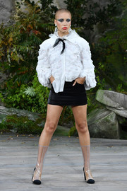 Adwoa Aboah got dolled up in a long-sleeve white ruffle blouse for the Chanel runway.