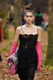 Kaia Gerber's fingerless pink opera gloves and black lace dress were a fancy combination!