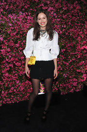 Atlanta de Cadenet topped off her chic black-and-white look with this tweed mini.