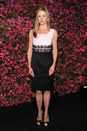Mira Sorvino chose a black and white cocktail dress that featured a black lace waist band.