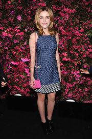 Kiernan Shipka chose patterned denim dress a checkered hem and pockets for her look at the Chanel Tribeca Film Festival Artists Dinner.