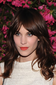 Alexa Chung kept her beauty and hair look natural and chic with a loose wavy cut and parted bangs.
