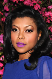 Taraji's jet-black tresses look sophisticated yet glamorous when styled into layered waves.
