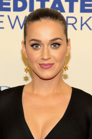 Katy Perry finished off her look with a pair of Christmas-inspired earrings.