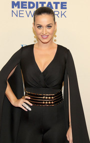 Katy Perry styled a catsuit with an oversized black and gold belt for her Change Begins Within benefit concert look.