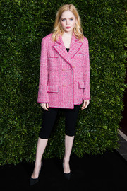 Ellie Bamber went casual on the bottom half in a pair of black capris.