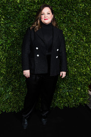 Melissa McCarthy layered a black blazer over a matching turtleneck for the Charles Finch and Chanel pre-BAFTA dinner.