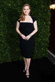 Amy Adams matched her dress with black ankle-strap peep-toes.