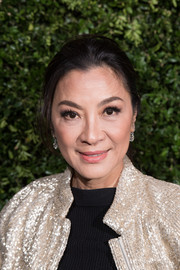 Michelle Yeoh sported a casual ponytail at the Charles Finch and Chanel pre-BAFTA dinner.