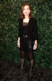 Isabelle Huppert polished off her look with a black tweed jacket.