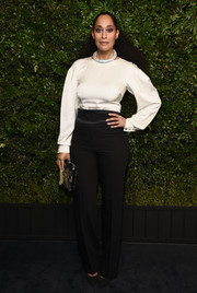 Tracee Ellis Ross paired her blouse with high-waisted tuxedo trousers.
