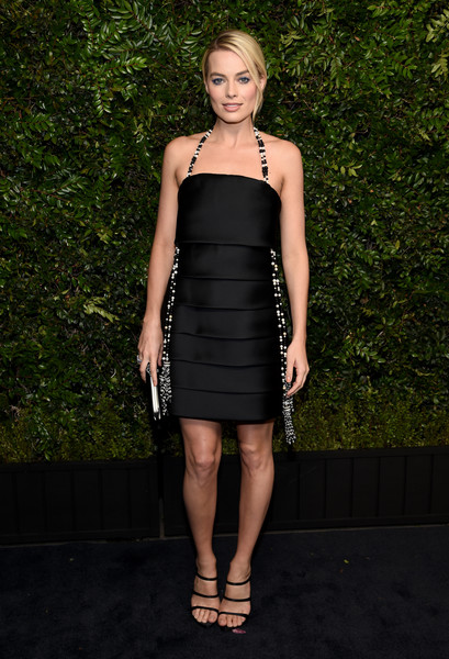 Margot Robbie coordinated her dress with a pair of strappy black Imagine by Vince Camuto heels.