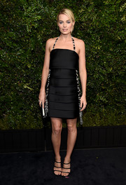 Margot Robbie looked super sophisticated in a tiered black halter dress by Chanel Couture at the Charles Finch pre-Oscar dinner.