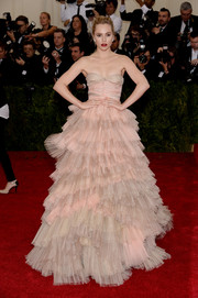 Suki Waterhouse went all out with the frills at the Met Gala in this nude and pink Burberry strapless gown featuring a voluminous, tiered skirt.