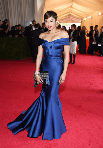 Alicia Quarles added some sparkle to her look via a bedazzled blue clutch.