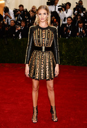 Rosie Huntington-Whiteley went for a rocker edge in an embellished leopard-print leather dress by Balmain during the Met Gala.