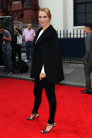 Uma went for minimal elegance with a pair of black skinny pants with a satin stripe down the sides.