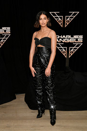 Naomi Scott kept it girly up top in a ruffled bra at the 'Charlie's Angels' photocall.