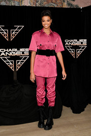 Ella Balinska donned a short-sleeve fuchsia button-down for the 'Charlie's Angels' photocall.