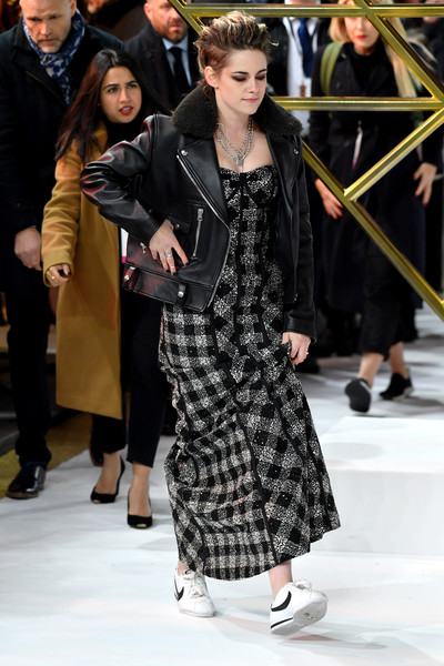 Kristen Stewart arrived for the UK premiere of 'Charlie's Angels' wearing a black Acne Studios leather jacket over a plaid gown.