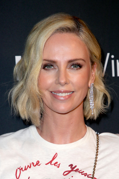 Charlize Theron Diamond Chandelier Earrings [hair,eyebrow,face,blond,human hair color,beauty,hairstyle,chin,forehead,layered hair,indiewire honors 2018,no name,los angeles,california,charlize theron]