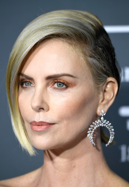 Charlize Theron Dangling Diamond Earrings [face,hair,eyebrow,hairstyle,chin,blond,skin,forehead,cheek,lip,arrivals,charlize theron,critics choice awards,santa monica,california,barker hangar]