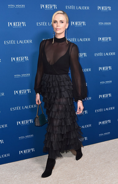 Charlize Theron Leather Purse [clothing,dress,fashion,cocktail dress,fashion design,cobalt blue,shoulder,electric blue,footwear,carpet,incredible women gala 2018 - arrivals,porter,charlize theron,los angeles,the ebell,california,third annual incredible women gala]